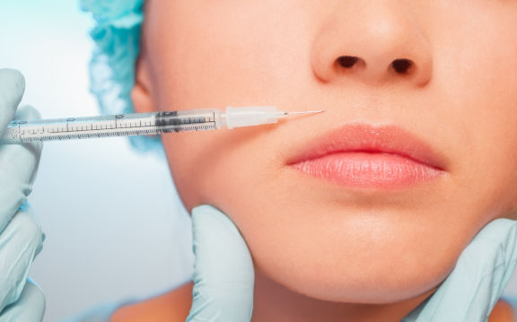 injection of Botox on a woman's face