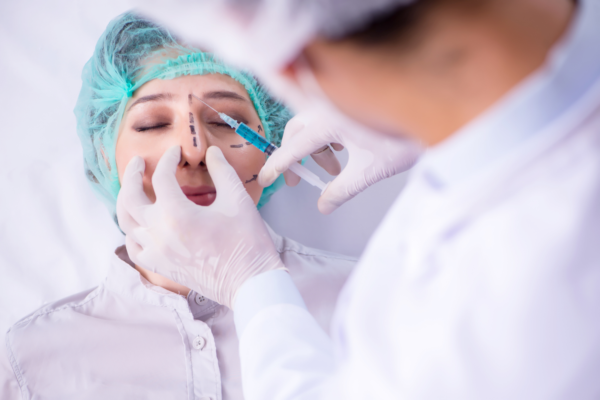surgeon preparing for rhinoplasty
