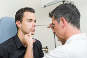 doctor examining nose