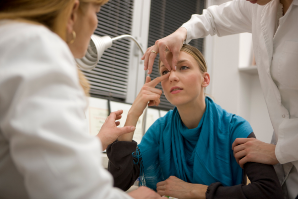 doctors and patient discussing rhinoplasty
